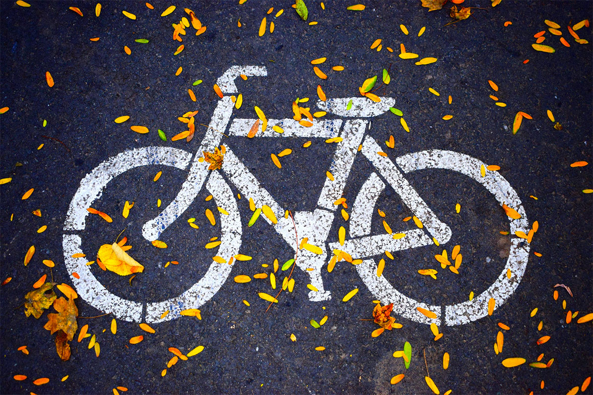 Photo of a bike symbol on a paved bike path